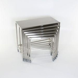 stainless steel nested instrument tables also known as back tables are used in operating rooms in medical facilities.